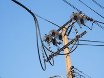 Chaotic wire and concrete electricity post Stock Image