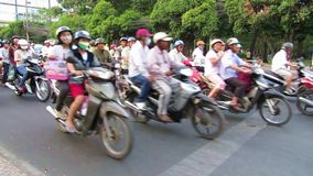 Chaotically road traffic in Saigon, Vietnam. HO CHI MINH - FEB15: Chaotically road traffic in Saigon (Ho Chi Minh City). In the biggest city are more than 4 stock video footage