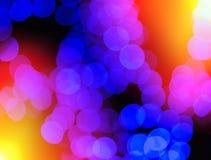 Chaotische blaue Kleckse mit hellem Leck bokeh Hintergrund Lizenzfreie Stockfotos