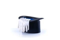 Chapéu alto preto do mágico com um par das luvas brancas Foto de Stock