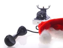 Chapéu de Papai Noel e telefone velho fotografia de stock royalty free