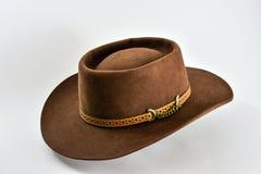 Chapéu de vaqueiro marrom do vintage no fundo branco Imagens de Stock