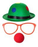 Chapéu do palhaço com vidros e o nariz vermelho Foto de Stock Royalty Free