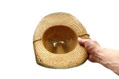 Chapéu do ` s do ancião em sua mão, isolada no fundo branco Imagens de Stock Royalty Free