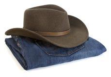 Chapéu e calças de ganga de cowboy Fotografia de Stock