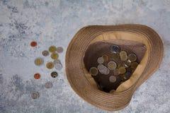 Chapéu e moedas Imagem de Stock