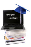 Chapéu e portátil da graduação Fotos de Stock