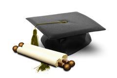 Chapéu e rolo da graduação foto de stock