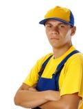 Chapéu e uniforme desgastando de basebol do trabalhador novo Foto de Stock