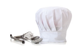 Chapéu e utensílios do cozinheiro chefe Imagens de Stock Royalty Free