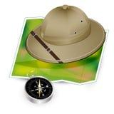 Chapéu, mapa e compasso do safari