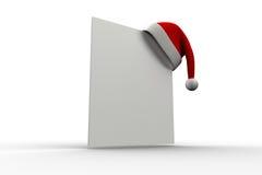 Chapéu vermelho de Santa que pendura no cartaz Fotografia de Stock