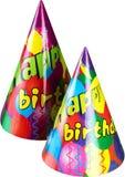 Chapéus do feliz aniversario no fundo branco fotos de stock royalty free
