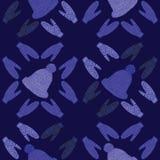 Chapéus e mitenes em uma obscuridade - fundo azul Imagens de Stock