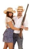 Chapéus ocidentais ambos da arma dos pares que olham Fotografia de Stock Royalty Free