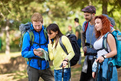 Free Chap And Lassie From Hiking Group Study Map Royalty Free Stock Image - 68232306