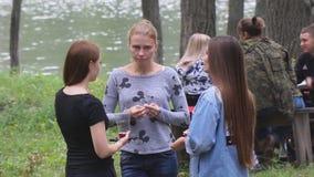 Three girl friends talking