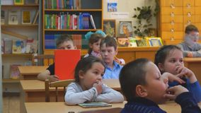 School children sit at their desks and listen to teachers. Chapaevsk, Samara region, Russia - May 10, 2019: Elementary school of the city of Chapaevsk stock video footage