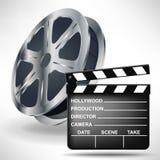 Chapaleta de la película con el rollo de película Fotografía de archivo
