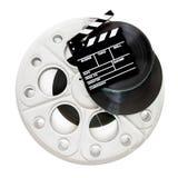 Chapaleta de la película en los rollos de película del cine de 35 milímetros aislados Foto de archivo libre de regalías