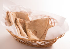 Chapati in basket. On white background royalty free stock photo