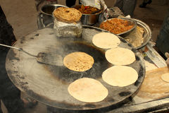 Chapati cooking Stock Images