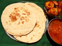 Chapati, Indian bread. Made with wheat flour, with cauliflower curry and red sauce stock photos