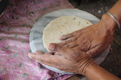 Chapatis with potatoes. Cooking hands breakfasts India. Chapatis with potatoes Stock Images