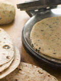 Chapatti Press with Chapatti Breads. Close up of Chapatti Press with Chapatti Breads stock photos