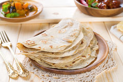 Chapatti roti. Or Flat bread, curry chicken and dhal. Indian food on dining table Stock Photos