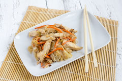 Chapchae - Asian dish of glass noodles with chicken and vegetabl Royalty Free Stock Images