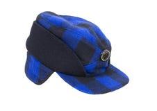 Chapeau bleu de chasseurs de plaid image stock