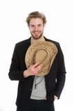Chapeau de cowboy américain à disposition d'homme d'affaires heureux Images stock