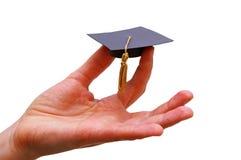 Chapeau de diplômé de main Photo stock
