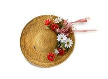 chapeau de paille avec des fleurs Photo libre de droits