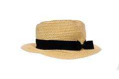 Chapeau de paille d'isolement avec le noeud noir de ruban photographie stock libre de droits