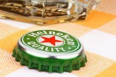 Chapeau en métal de bière de Heineken Image libre de droits