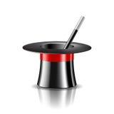 Chapeau et baguette magique magiques de magie sur le fond blanc Image libre de droits