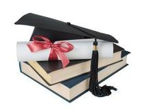 Chapeau, livres et rouleau licenciés Photos libres de droits
