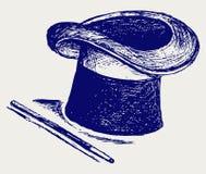 Chapeau magique avec la baguette magique magique Photographie stock