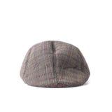 Chapeau plat dans le tweed gris et brun d'isolement Photographie stock libre de droits