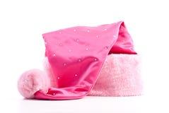 Chapeau rose de Santa Images libres de droits