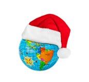 Chapeau rouge de Noël de globe et de Santa Claus Photographie stock libre de droits