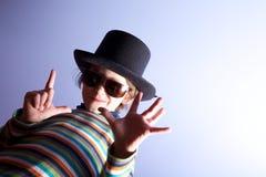 Chapeau s'usant de jeune garçon Image libre de droits