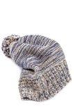 Chapeau tricoté coloré d'hiver sur un blanc Photographie stock libre de droits