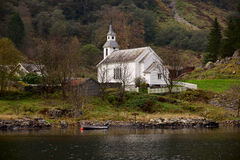 Isolated cottage located in Sognefjord. Bradley Dahl Chapel Culture,Located in the fjord Stock Photos