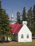Chapel. A small chapel with a red roof surrounded by trees stock photo