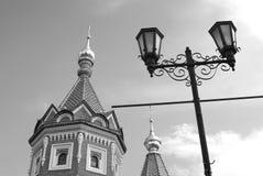 Chapel of Alexander Nevsky and street light. Black and white photo. Stock Image
