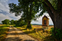 Chapel in the alley. Chapel in the linden alley on a hot summer afternoon Stock Photo