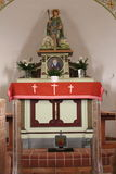 Chapel Altar. From 1908 in Germany with flowers and candles Stock Image
